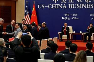 Chinese President Xi Jinping and US President Donald Trump witnessing US and Chinese business leaders signing trade deals in Beijing last November. There is no guarantee that the US will remain benevolent when confronted with mounting economic and st