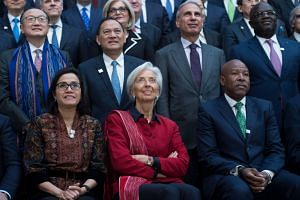 Christine Lagarde (centre) looks on during the group photo at the IMF/World Bank spring meeting in Washington.