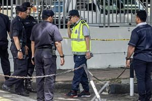 Royal Malaysian Police officers collecting evidence at the scene of the drive-by shooting of Palestinian scientist Fadi Mohammad al-Batsh, on April 21, 2018.