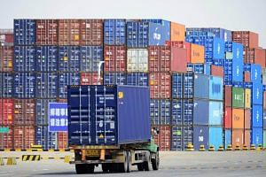 File photo showing shipping containers at a cargo terminal in a port in Qingdao, Shandong province, China.