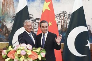 Pakistan's Foreign Minister Khawaja Muhammad Asif and Chinese State Councilor and Foreign Minister Wang Yi during a press conference after their meeting at the Diaoyutai State Guest House in Beijing, on April 23, 2018.