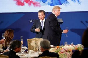 South Korean President Moon Jae In hosting US President Donald Trump to a state dinner at the Blue House in Seoul on Nov 7, 2017.
