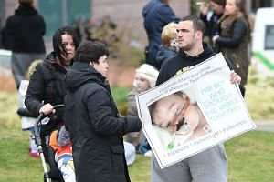 Supporters react to the announcement that the European court of human rights refused to intervene in the case of British toddler Alfie Evans outside Alder Hey childrens hospital in Liverpool, on April 23, 2018.