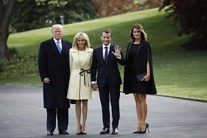 US President Donald Trump (left) and first lady Melania Trump (right) pose with French President Emmanuel Macron and his wife Brigitte Macron as they walk to a tree planting ceremony together in Washington, US, on April 23, 2018.