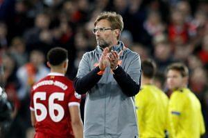 Liverpool manager Juergen Klopp applauds fans after the match.