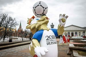 Zabivaka, the official World Cup mascot, on display in Moscow. Singtel, StarHub and Mediacorp have collaborated for the first time to deliver TV packages for local fans.
