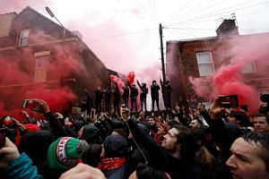 Football fans outside Anfield stadium before the Champions League match between Liverpool and AS Roma on April 24.