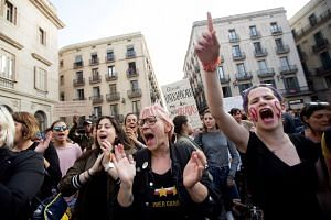 Thousands attend a protest in Barcelona after the verdict.