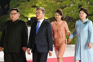 (From left) North Korea's leader Kim Jong Un, South Korea's President Moon Jae In, Kim Jong Un wife's Ri Sol Ju and Moon Kae In's wife Kim Jung Sook during a farewell ceremony at the end of their historic summit at the truce village of Panmunjom on A
