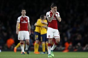Arsenal's Spanish defender Hector Bellerin (right) reacts on the pitch after the match.