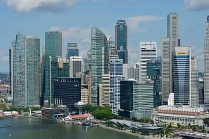 """The Monetary Authority of Singapore reiterated its expectation for full-year gross domestic product growth to come in """"slightly above the middle of the forecast range"""" of 1.5 per cent to 3.5 per cent."""
