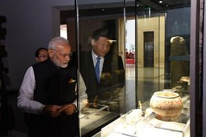 India's Prime Minister Narendra Modi (left) and Chinese President Xi Jinping viewed antique Chinese artefacts at the Hubei Provincial Museum on April 27, 2018.