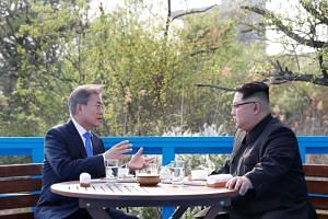 South Korean President Moon Jae In and North Korean leader Kim Jong Un meet at the truce village of Panmunjom inside the demilitarized zone separating the two Koreas, South Korea, on April 27, 2018.