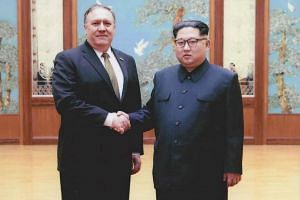"""New US Secretary of State Mike Pompeo (left) said he had a """"good conversation"""" with North Korean leader Kim Jong Un during his visit to Pyongyang."""