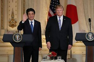 US President Donald Trump (right) and Japanese Prime Minister Shinzo Abe spoke in a 30-minute phone call on April 28 and agreed on the importance of concrete steps towards denuclearisation by Pyongyang.