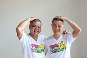 Mr Toh Yi Qin (right) and his cousin Chua Ching Chong after shaving their heads at the Hair for Hope event at Kong Meng San Phor Kark See Monastery on April 29, 2018.