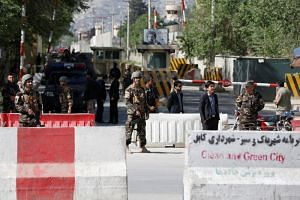 Afghan security forces stand guard near the site of the blast in Kabul, Afghanistan, on April 30, 2018.