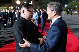 North Korea's leader Kim Jong Un (left) and South Korea's President Moon Jae In bidding farewell during the closing ceremony of the inter-Korea summit in the truce village of Panmunjom.