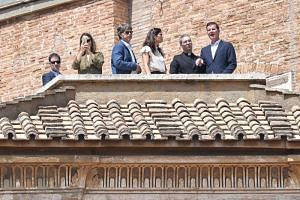 (From left) Mr Jose Andres Murillo and his wife, Mr James Hamilton and his wife and Mr Juan Carlos Cruz, accompanied by a priest, attending the Sunday Angelus prayer delivered by the Pope from the window of the apostolic palace on April 29, 2018. Mr