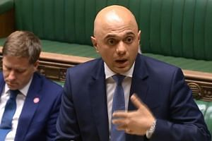 Britain's Home Secretary Sajid Javid speaking on the Urgent Question regarding Windrush in the House of Commons at Parliament in London on April 30, 2018.
