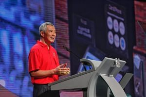 Prime Minister Lee Hsien Loong urged workers and businesses to continue with upgrading and transforming, to sustain the momentum of economic restructuring.