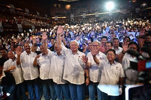 PM Najib Razak (fourth from right) waving to his supporters at a Labour Day event in Kuala Lumpur, on May 1.