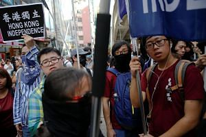 Pro-independence activists take part in a march marking the 20th anniversary of Hong Kong's handover to Chinese sovereignty from British rule, in Hong Kong, China on July 1, 2017.