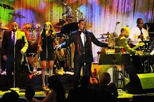 Singer R. Kelly performs during the Pre-Grammy Gala and Salute to Industry Icons in Beverly Hills in 2011. The R&B star has faced repeated allegations of mistreatment of underage girls and young women.