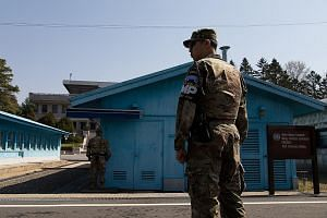 A US soldier standing guard at the United Nations Command Military Armistice Commission in the truce village of Panmunjom in the Demilitarised Zone last month.