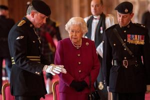 Britain's Queen Elizabeth after presenting the regiment with their new standard in St George's Hall at Windsor Castle in Windsor, Britain, on April 25, 2018.