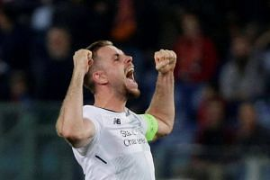 Liverpool's Jordan Henderson celebrates after the match against Roma on May 2, 2018.