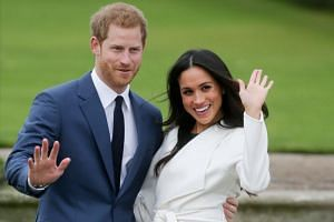 Britain's Prince Harry and his fiancée, US actress Meghan Markle, in the Sunken Garden at Kensington Palace in west London, following the announcement of their engagement on Nov 27, 2017.