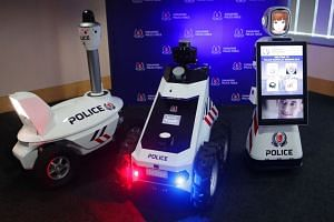 (From right) The S5 pan-tilt-zoom patrol robot, Multi-purpose, all-terrain, autonomous robot and Future robot – display, that were unveiled at the Singapore Police Force's (SPF) annual workplan seminar.