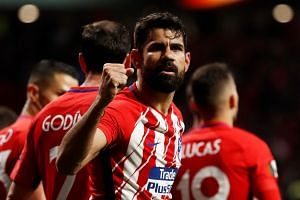 Atletico Madrid's Diego Costa celebrates scoring their first goal.