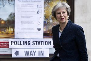 British Prime Minister Theresa May arrives to vote in the local elections at Central Methodist Hall, in London, on May 3, 2018.