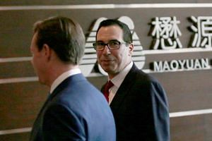 """US Treasury Secretary Steven Mnuchin (right) arriving at a hotel in Beijing, China, on May 3, 2018. """"We are having very good conversations,"""" Mr Mnuchin told reporters."""