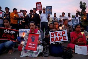 People participate in a candle light vigil to protest against the rape of a girl in Kathua near Jammu, and a teenager in Unnao, Uttar Pradesh state, in Bengaluru, India, on April 13, 2018.