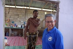 International Trade and Industry Minister Mustapa Mohamed, who is also Umno chief for Kelantan state, visiting a constituent in the rural seat of Jeli. He is optimistic that BN can recapture Kelantan from PAS.