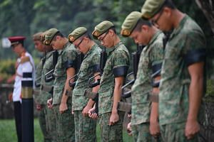 Army personnel keep one minute of silence for Corporal First Class Dave Lee Han Xuan.