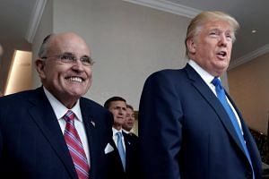 A file photo of US President Donald Trump with Mr Rudy Giuliani at the new Trump International Hotel in Washington, DC, on Sept 16, 2016.