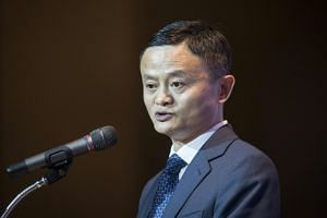 Alibaba founder Jack Ma speaks before a signing ceremony in Bangkok on April 19, 2018, during a visit to the country to announce an investment plan.