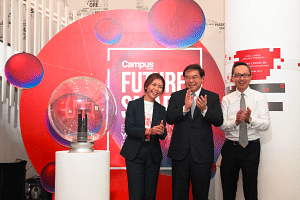 From left: Ms Yap Aye Wee, OCBC Bank's head of learning and development, group human resources; Mr Samuel Tsien, group CEO; and Mr Jason Ho, head of group human resources, at the launch of the OCBC Future Smart Programme.