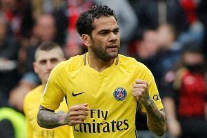 Dani Alves celebrates a goal for Paris Saint-Germain.