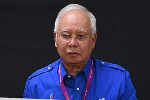 Barisan Nasional's Najib Razak voting at a polling station during the 14th general elections in Malaysia on May 9, 2018.