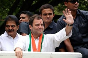 Rahul Gandhi waving to his supporters during a political rally in Bangalore, India, on May 9, 2018, ahead of the Karnataka Assembly election.