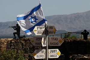 An Israeli flag is seen on Mount Bental in the Israeli-annexed Golan Heights on May 10, 2018.