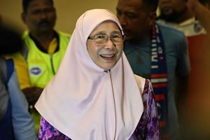 Justice Party president Wan Azizah smiles after visiting her husband, jailed former opposition leader Anwar Ibrahim, at the Cheras Rehabilitation Centre hospital in Kuala Lumpur, on May 11, 2018.
