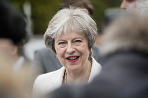 May (above) raised the potential impact of US sanctions on firms currently conducting business in Iran.