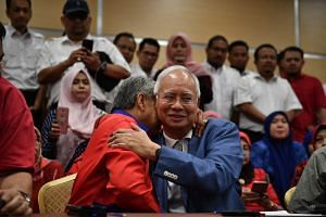 Datuk Seri Najib Tun Razak hugs Umno vice-president Datuk Seri Dr Ahmad Zahid Hamidi during a press conference in Kuala Lumpur on May 12, 2018.