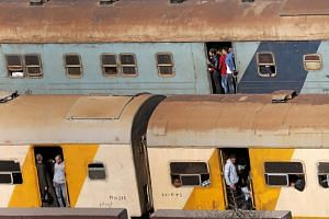 People travel on overcrowded trains in Cairo, Egypt.